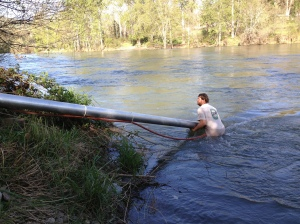Jeff had to go into the river to place the pump correctly.