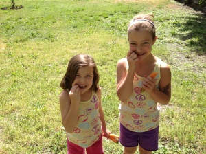 Our neighbors, Kianna and Tayla, munching on our sweet carrots like little rabbits