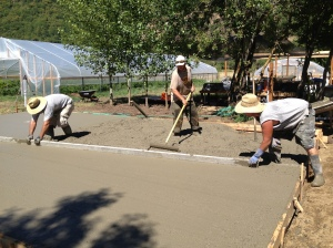 Smoothing out the concrete pad